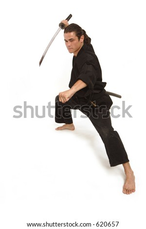 aggressive move of a martial artist with katana - stock photo
