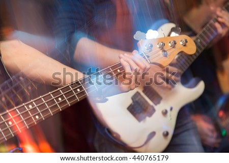 aggressive play guitar on stage - stock photo