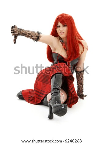 aggressive schoolgirl in black latex boots showing thumbs down - stock photo