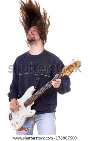 aggressive talented male musician playing bass guitar with hair up