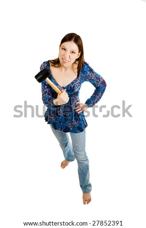 Aggressive woman holding hammer in her hand and looking straight