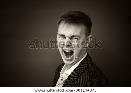 Aggressive young manager in a business suit. Black and white photo - stock photo
