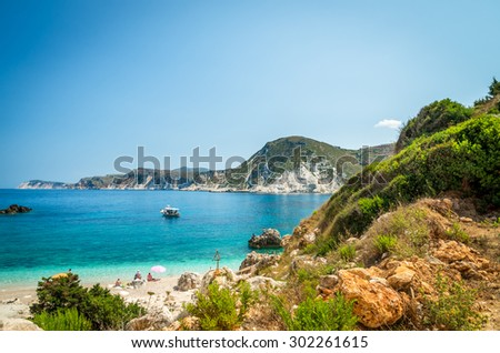 Agia Eleni beach Kefalonia, Greece. People relaxing on one of the most beautiful rocky wild beaches of Kefalonia.