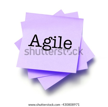 Agile written on a note - stock photo