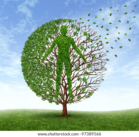 Aging and disease with a tree leaves with branches in the shape of an old  human losing foliage as dying or loss of health due to age related illness as alzheimer and dementia or terminal cancer. - stock photo