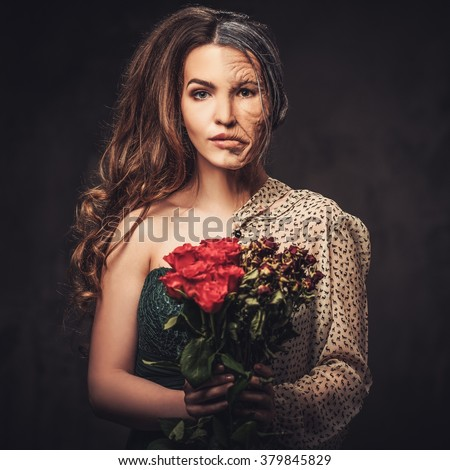 Aging and skin care concept. Half old half young woman with bouquet of red roses.  - stock photo