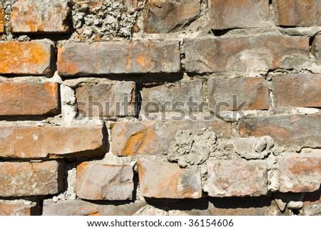 aging brick wall - stock photo