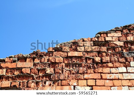 aging brick wall on celestial background - stock photo