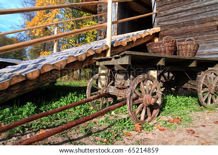 aging cart near wooden building - stock photo