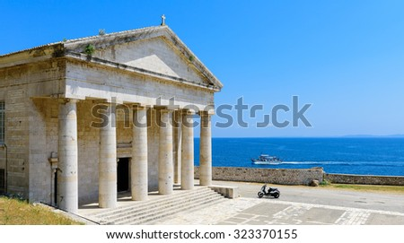 Agios Georgios Church at Corfu Old Fortress with the Ionian sea and a tourist ship at the background, Corfu, Greece. - stock photo