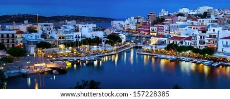 Agios Nikolaos at night on Crete, Greece. - stock photo