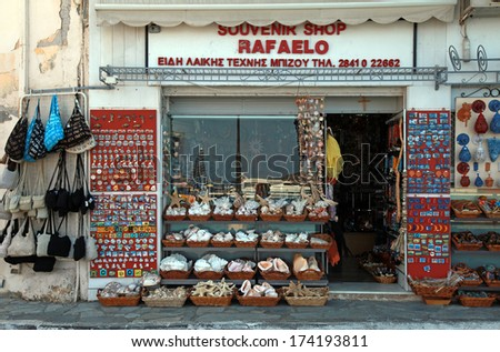 AGIOS NIKOLAOS, GREECE - JULY 18, 2012: Local souvenir shop  where tourists can buy sea shells, magnets and other greek gifts in Agios Nikolaos, Greece.