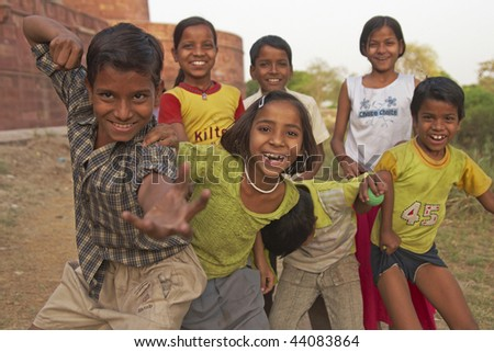AGRA, INDIA - APRIL 7: Group of boisterous Indian children pose for photograph on April 7, 2009 in Agra, Uttar Pradesh, India. - stock photo