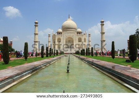 AGRA, INDIA - AUGUST 18: Tourists visit Taj Mahal, Agra, India on August 18, 2014. The Taj Mahal is a mausoleum located in Agra, India and is one of the most recognizable structures in the world.
