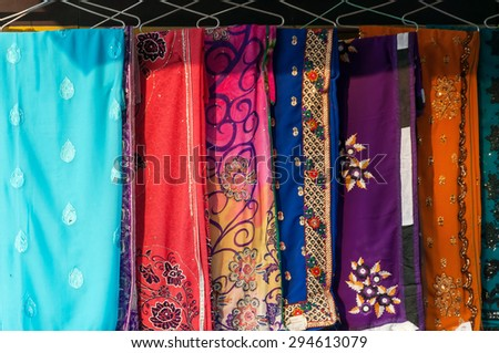 AGRA, INDIA - DEC 17, 2014: Colorful different sari on street market in Agra. Sari is the traditional women's clothing for India - stock photo