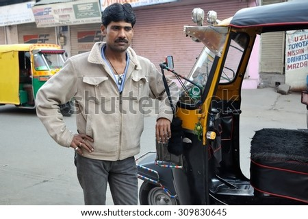 AGRA , INDIA - DECEMBER 27 : Undefined driven take a photo with our auto rickshaw at Agra in the northern state of Uttar Pradesh on December 27,2010 in Agra, India.  - stock photo