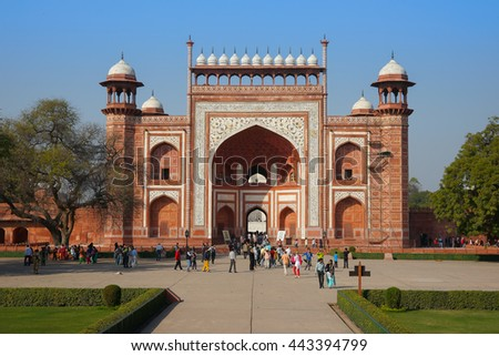 AGRA, INDIA - FEBRUARY 03, 2014: People walk next to one of the gates at Taj Mahal complex, Agra, Uttar Pradesh, India.