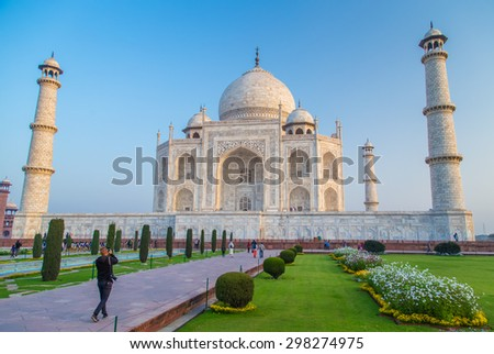 AGRA, INDIA - 28 FEBRUARY 2015: View of Taj Mahal towards South side. Visitor with camera. - stock photo