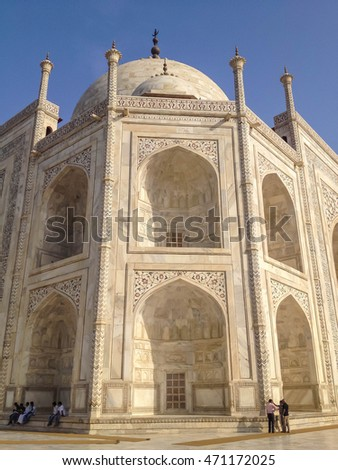 AGRA, INDIA - JULY 12, 2014 : Taj Mahal is an ivory-white marble mausoleum on the south bank of the Yamuna river in the Indian city of Agra, India