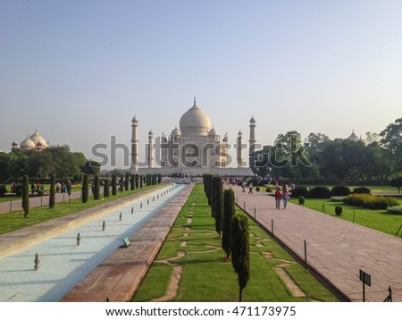 AGRA, INDIA - JULY 12, 2014 : Taj Mahal is an ivory-white marble mausoleum on the south bank of the Yamuna river in the Indian city of Agra.