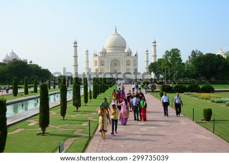 AGRA, INDIA - JULY 18, 2015: The people visit Taj Mahal, Agra, India. The Taj Mahal is a mausoleum located in Agra, India and is one of the most recognizable structures in the world. - stock photo