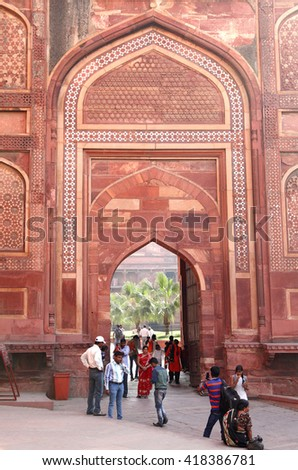 AGRA, INDIA-JUNE 29: Tourists visiting the ancient 11th century Agra Fort, Agra, India on March 29, 2016. Agra Fort is a Mughal Architectural Masterpiece - stock photo