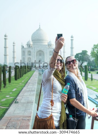 AGRA, INDIA - MAY 7 : Unidentified tourists visit India's most famous icon, the Taj Mahal on MAY 7,2015 in Agra, India. The Taj Mahal designated a UNESCO World Heritage Site in 1983. - stock photo