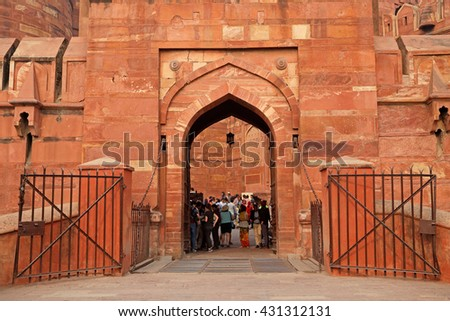 AGRA, INDIA - NOVEMBER 29, 2015: Entrance to the historical Red Fort of Agra - a UNESCO world heritage site - with visiting tourists  - stock photo