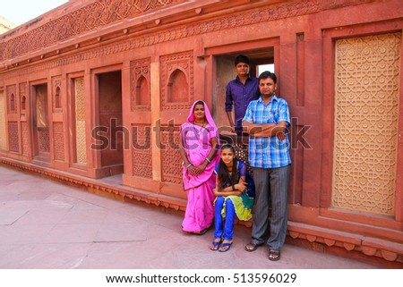 AGRA, INDIA - NOVEMBER 7: Unidentified people visit Jahangiri Mahal in Agra Fort on November 7, 2014 in Agra, India. The fort was built as a military structure, but was later upgraded to a palace.