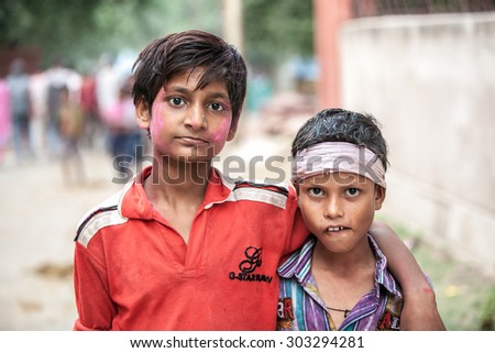 Agra, India - 03 October, 2014: Portrait of Indian boys in the crowd during Durga Puja celebrations on the street of Agra on 03 October, 2014, Agra, India. - stock photo