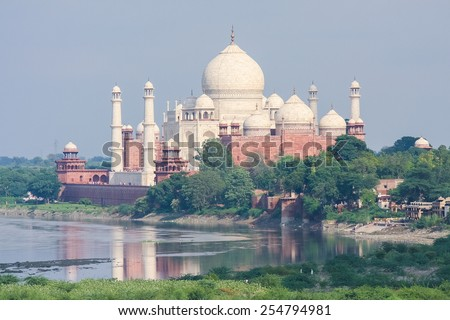 "AGRA, INDIA - SEPTEMBER 21, 2008: View from Agra Fort on the Taj Mahal, the ""jewel of Muslim art in India"", white marble mausoleum in Agra, Uttar Pradesh, India - stock photo"