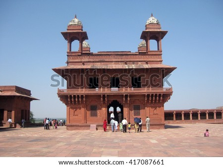 Agra, Uttar Pradesh, India - October 2011: The monument Diwan-i-Khas and tourists in the Fatehpur Sikri Palace, a UNESCO World Heritage. - stock photo