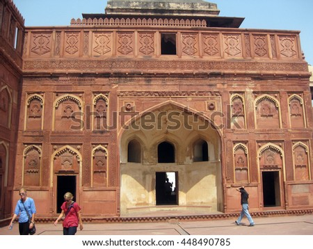 Agra, Uttar Pradesh, India - October 2011: Tourists at a monument inside the Agra Fort. - stock photo