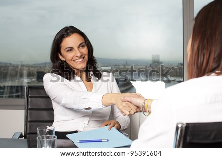 Agreement between real estate agent and buyer - stock photo