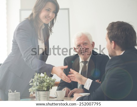 Agreement between two businesspeople during company conference - stock photo
