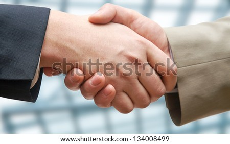 Agreement: business partners handshaking - stock photo