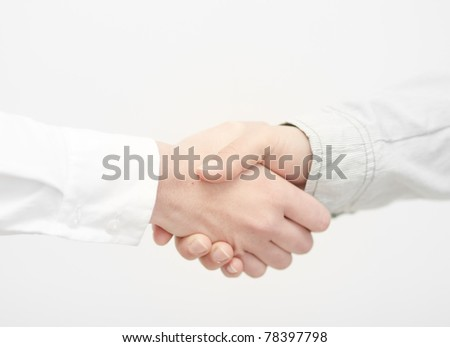 Agreement. Business people shaking hands