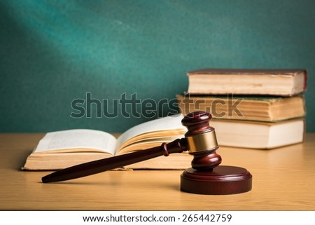 Agreement. Legal system concept gavel and law books in courthouse - stock photo