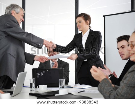 Agreement signed, hand shaking - stock photo