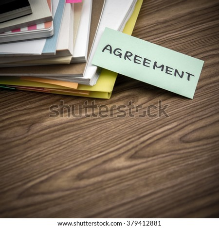 Agreement; The Pile of Business Documents on the Desk
