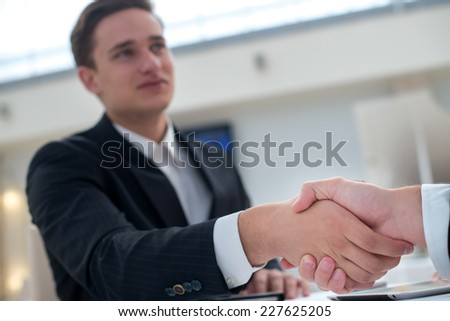 Agreement with a handshake. Motivated and successful businessmen is shaking hand to his business partner - stock photo