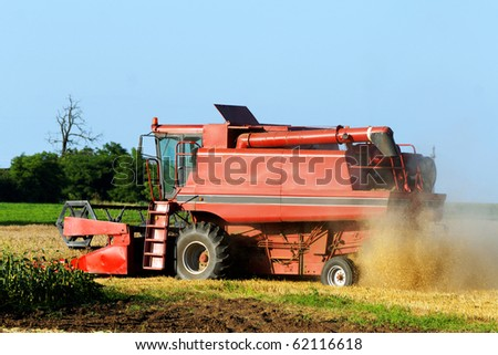 Agricultural combine in a field