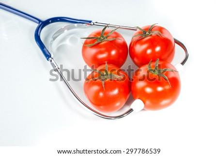 Agricultural diagnose,  tomato, stethoscope - stock photo