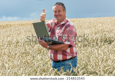 Agricultural engineer at the field inspection - stock photo