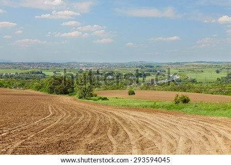 Agricultural field in late sunlight - stock photo