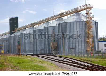 Agricultural grain elevator building for corn storage and railroad. - stock photo
