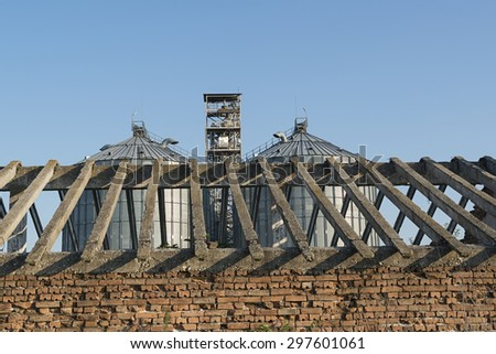 Agricultural grain Silo - Building Exterior, Storage and drying of grains, wheat, corn, soy, sunflower - stock photo