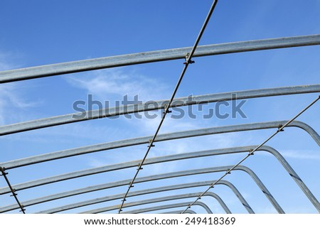 Agricultural greenhouses skeleton under the blue sky