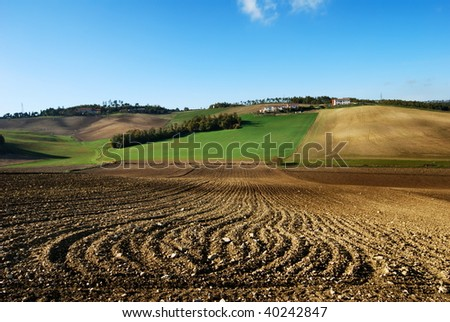 Agricultural landscape with lines in plowed field