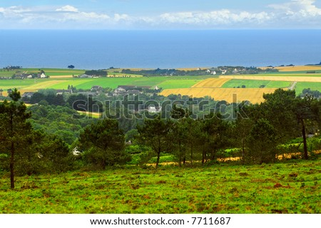 Agricultural landscape with scenic ocean view in rural Brittany, France